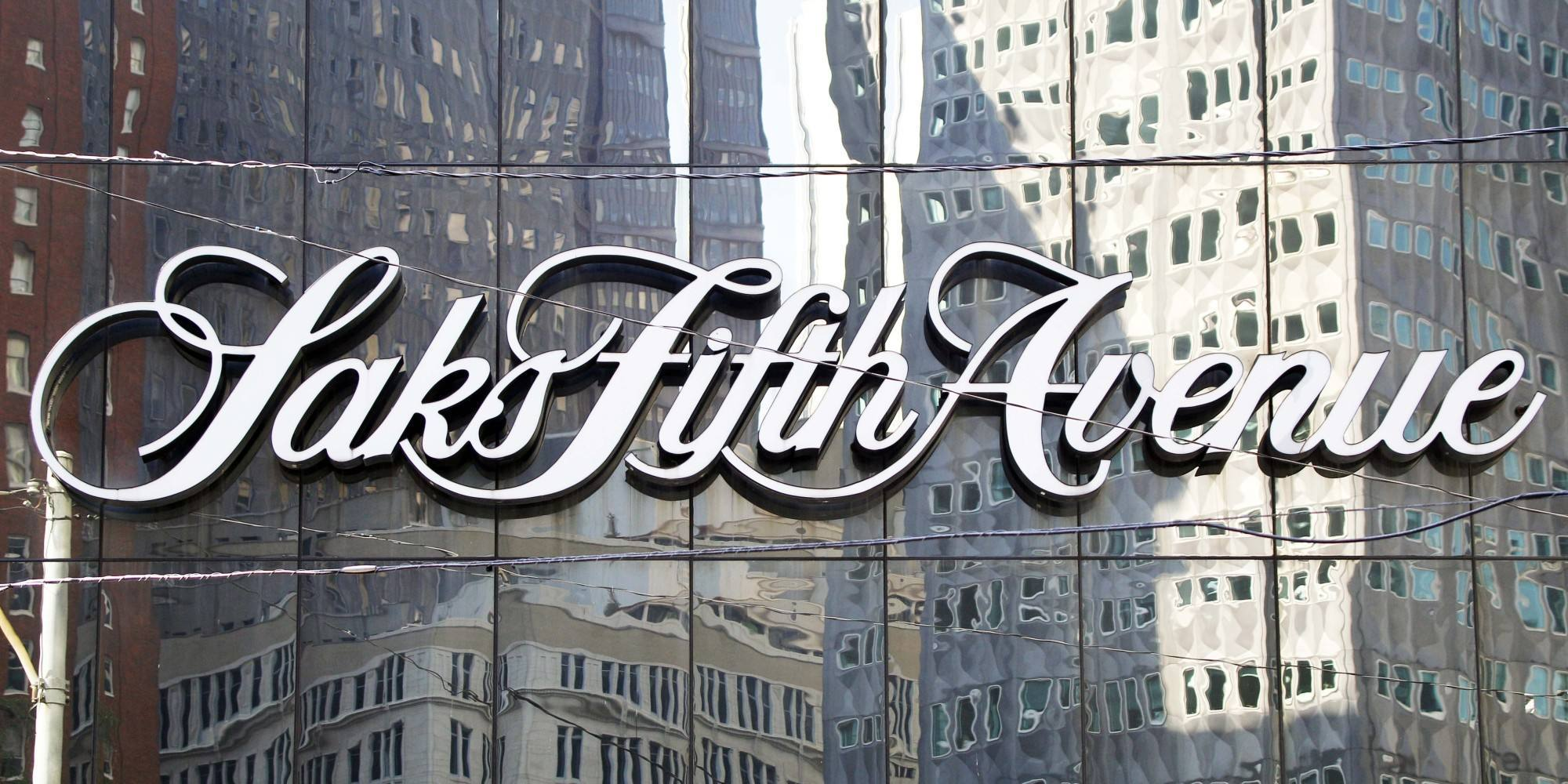 Downtown Pittsburgh buildings are reflected in the facade holding the sign on the Saks Fifth Avenue department store on Thursday, Oct. 6, 2011. Saks Fifth Avenue announced on Wednesday Oct. 5, 2011 that it will be closing this store after they couldn't raise the funding needed for improvements to the store. (AP Photo/Keith Srakocic)